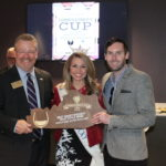 Best Sweet/Dessert/Fruit Wine: KDA Chief of Staff Keith Rogers, Miss Kentucky Laura Jones and KDA/KY Grape & Wine Council Program Manager Tyler Madison accepting on behalf of Baker-Bird Winery